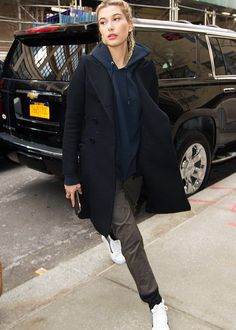 Style Notes: Hailey Baldwin has become quite the poster girl for the sofa-dressing movement—doing the hoodie-under-overcoat styling trick that we've seen across fashion week.