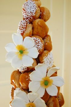 "Croquembouche! That's French for ""crunch in the mouth"", and this tall, elegant stack of cream puffs glued together with caramel candy definitely does. Find out how to make one at www.joepastry.com!"
