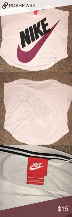 Nike Tee Great Nike t shirt. This has been sitting in my closet for so long! I think I've worn this once or twice. No damage (rips/stains/tears). Size medium white black and pink Nike logo women's shirt. Nike Tops Tees - Short Sleeve