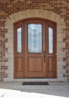 Arched top entry door in a colonial maple finish bought at www.nicksbuilding.com #exteriordoorswithsidelights #archedtopwooddoors  #exteriordoorswithglass Exterior Doors With Sidelights, Arched Front Door, Exterior Doors With Glass, Front Porch, Interior And Exterior, Entrance Doors, Garage Doors, Doors Online, Main Gate