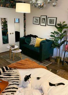 Before and After: A tiny blah beige studio goes tropic-glam for $1,500. #studio #studiomakeover #studioapartment #studiodecor #decoratingideas #smallspaces #smallspacehacks #boho #bohoglam #glamdecor Living Room Paint, Living Room Decor, Living Rooms, New Furniture, Living Room Furniture, Faux Wood Flooring, Before After Home, Green Velvet Sofa, Interior Design Themes