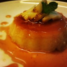 Caramel custard with pineapple and mint