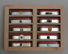 Altoids tins become storage compartments.
