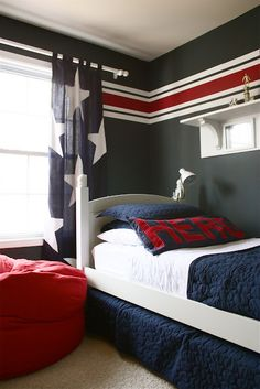 I like the stripes on the wall......khaki background and blue and red stripes for a route 66 theme