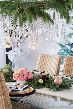 Festive Christmas dining room with icicle chandelier and fresh greenery by Cuckoo4Design