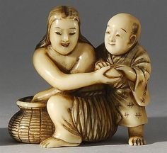 Ivory netsuke, pearldiver and youth beside a wicker basket.   Rantei, 19th century
