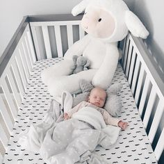 white and gray babys room