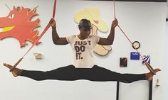 Impressive: Tennis great Serena Williams does the splits in mid-air in this Instagram photo she shared with fans on Thursday. 'Fearless,' Williams wrote: '#strongisbeautiful. just do it.' #SerenaWilliams wore a white Nike Tshirt with the 'Just Do It' logo as she worked out in the gymnastics center.  In the photo, the athlete shows perfect form as she pulls the splits while balancing on two gymnastics rings as she hovers above the mat.  Read more: http://www.dailymail.co.uk/tvshowbiz/article-
