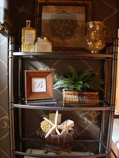 Shelving unit with accessories in creams and golds