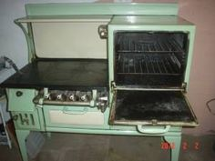 1930's Wedgewood Stove wood/gas burning Cast Iron Nice old stove 47 inches wide
