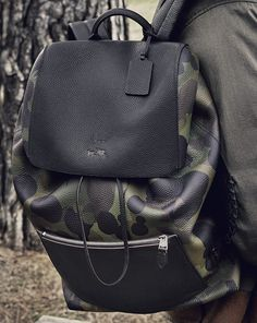 Our spacious Manhattan Backpack is unexpectedly urban in an exclusive military-inspired Coach camo print featuring Gary Baseman's Wild Beast motif.