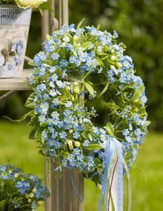 Summer outdoor wreath  /////  Beautiful shade of blue for summer.  Light blue with ribbon and green leaves.