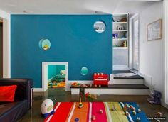 Kids Room: Modern Playroom Ideas Below The Stairs With Blue Wall Theme And Black Sofa With Colorful Rug: Colorful Kids Playroom Design Ideas Diy Casa, Hidden Rooms, Playroom Design, Playroom Ideas, Loft Playroom, Playroom Mural, Ikea Design, Basement Ideas, Secret Rooms