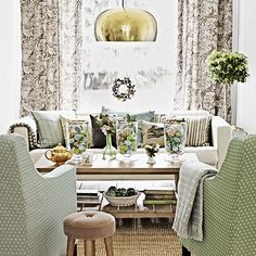This beautiful living room has been decorated in a fresh, seasonal palette of greens, neutrals and pastels.