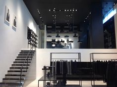 The retail space is defined by so-called open and full areas, with simple modular elements added that are fully compatible with CoSTUME NATIONAL's avant-garde aesthetics.