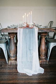 Thoughtful and introspective bridal shoot by Sara Weir, featuring a candlelit tablescape in grey and burgundy