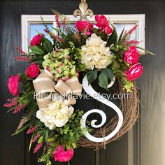 """This gorgeous spring wreath is so beautiful! A 14"""" curly monogram adds a personal touch!"""