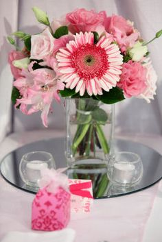 Main concept for centerpieces- multiple pink/ivory flowers-varried.  looking for silver vases/containers.
