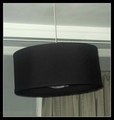 DIY Easy Peasy Drum Shade Chandelier: 2 quilting hoops, flexible plexiglass and fabric.
