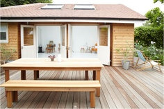 Nice deck and simple wood table/benches.
