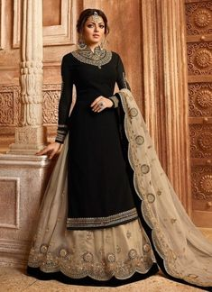 Bollywood diva drashti dhami style black designer lehenga style suit online which is crafted from satin georgette fabric with exclusive embroidery, zari and stone work. This stunning designer lehenga style suit comes with net bottom and net dupatta. Black Lehenga, Lehenga Suit, Lehenga Style, Party Wear Lehenga, Party Wear Dresses, Salwar Suits, Net Lehenga, Silk Anarkali Suits, Indian Salwar Kameez