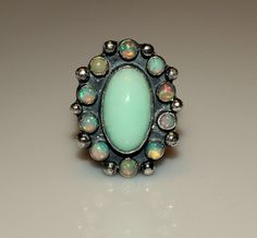 Not your mamma's opals!  Pretty blue/green Croatian opal focal, surrounded by #ethiopian #opal accents in a #handmade oxidized #ring.  Offered by MyFascinationStreet on #Etsy!
