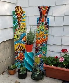 Bohemian funky painted yard art. These will really add a pop of color to your garden, under a tree, on a porch or along a fence. Stake can be added to place in the ground for a free standing artwork in a garden. Hanger can be added to hang on a porch, fence or any wall. Free standing, they can go