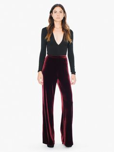 A flattering, silky style constructed from stretch velvet for a touchable feel and long-wearing comfort. The Velvet Wide Leg Pant features a high waist with tonal waistband, back darts,  bootcut silhouette, and zipper with button closure. This pant wears true to size in a relaxed fit with moderate stretch.