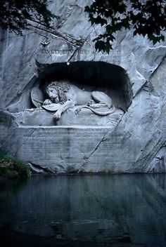 "Lion Monument~by Bertel Thorvaldsen Also known as the Lion of Lucerne, this sculpture in Lucerne, Switzerland, commemorates the Swiss Guards who were massacred in 1792 during the French Revolution. Mark Twain praised the sculpture of a mortally-wounded lion as ""the most mournful and moving piece of stone in the world"" and Mark Twain knew what he was talking about, guys."