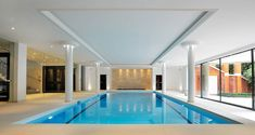 Luxury indoor swimming pool design & installation company based in Surrey. Winner of Master Pools Guild awards for design. Small Indoor Pool, Indoor Swimming Pools, Swimming Pool Designs, Best Interior Design, Modern Interior, Stock Kitchen Cabinets, Inside Pool, Building A Pool, Pool Furniture