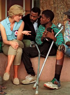 January 14, 1997: Diana, Princess of Wales talks with victims in Angola at an orthopedic center outside Luanda.