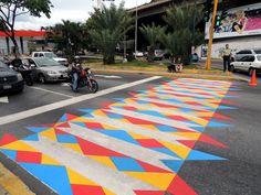 A crosswalk intervention made by street artist Rafael Fernandez(FLIX) Las Mercedes Avenue in Caracas Venezuela. Graffiti Designs, Graffiti Murals, Street Graffiti, Passage Piéton, Pedestrian Crossing, Road Markings, Urban Intervention, Las Mercedes, School Murals