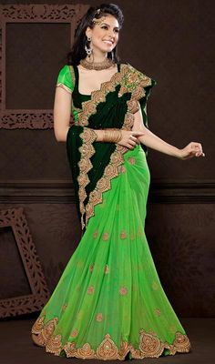 Green Shade Net and Velvet Half N Half Saree Portray a look of muse of solemn beauty draped in this green shade net and velvet half n half saree. The incredible attire creates a dramatic canvas with brilliant moti, multi, resham and stones work. Comes with a matching stitched round neck blouse with 6 inches sleeves. #OnlineEmbroideryIndianSarees #WeddingWearSarisFashion