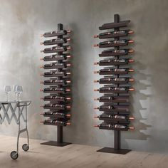 """The Dionisio, your vertical wine cellar, was designed in collaboration with the best wineries in Franciacorta. The shelves are designed to promote aging and preserve the natural taste of your wine. Painted steel/ Color: Rust 75"""" x 26.5"""" x 11.7"""" Please allow 2-4 weeks for shipping."""