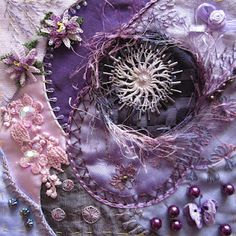 Purple themed Crazy quilt with buttons,  seed beading, silk ribbon flowers, motifs and ornate embroidery  stitching.