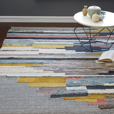 West Elm - a beautiful way to bring yellows and blues together, without it being too matchy-matchy with other furniture and artwork. Stunning. Multi Pixel Woven Rug