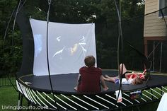 Outdoor Movie Night Ideas with Springfree Trampoline. Get free party printables and learn about the safest trampoline in the world. LivingLocurto.com