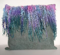Teeswater cushion.  Background fibre and locks all hand dyed.