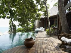 Song Saa Private Island Koh Rong, Cambodia Hotels tree property swimming pool home Resort backyard Courtyard wooden cottage Villa outdoor structure stone Outdoor Spaces, Outdoor Living, Outdoor Decor, Outdoor Furniture, Overwater Bungalows, Parasols, Island Resort, Cool Pools, Exterior Design