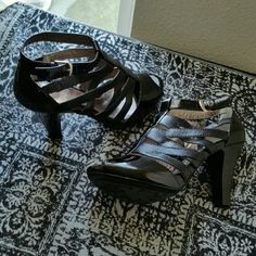 """SOFFT.......BEAUTIFUL BLACK....HEELS ...EXCELLENT CONDITION ...PRICE FIRM $30 ...BRAND NEW ...NWOT. ...NO FLAWS.. ...BEAUTIFUL  ...true to its size and color ...2 pic up close ...patent shine back ...patent shine on front ...open toe heels ...gladiator style ...leather feel ...straps on front  ... 4 """" HEEL ...better in person. Sofft Shoes"""