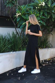 black maxi dress with side slits and white sneakers. Visit Daily Dress Me at dailydressme.com for more inspiration