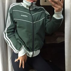 Olive green adidas originals zip up jacket Fits like a small even though tag says medium. Perfect condition no flaws. ❤️ All items bought ships the same day or the next day at the latest. ❤️ Make an offer through the offer button only please ❤️ All items are in great like new condition unless stated otherwise. ❌ No trades and I only sell on poshmark Adidas Jackets & Coats