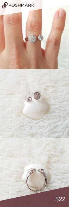 Cubic Zirconia Tipped Open Ring BEAUTIFUL cubic zirconia tipped open style ring! One side has a large round cut CZ, the other has numerous small CZ. Two sizes available,  size 6 or 7. Paragon Accents  Jewelry Rings