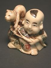 Japanese  netsuke - Chinese Boy has Cat on Leach,signed