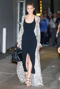 For a Jimmy Kimmel Live! appearance in New York City on November 10, #GigiHadid let her Roberto Cavalli duster (paired with a black Nanushka Aya dress, Stuart Weitzman Courtesan sandals and John Hardy earrings) trail behind her