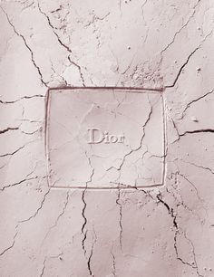 Dior cracked makeup powder imprint. Creative fashion still life photography of broken make up cosmetics. By luxury goods still life photographer, Josh Caudwell. For product and editorial photography in London, New York, Paris, Milan.