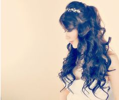Create soft curls with this half-up hairstyle. | 33 Impossibly Gorgeous Prom Hair Ideas