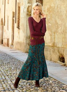 Persian florals in sepia, amber, magenta and mallard are strewn across the deep teal ground of this romantic maxi-skirt. Sewn of drapy viscose (95%) and elastane (5%) jersey, with a contoured yoke and sweeping, ankle-grazing hem.