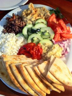 7/4/2013 Hummus platter - pita triangles with honey feta cheese. Pitas were cut into small triangle shapes with waffle pressed pattern. Served with hummus, artichoke quarters and tomatoes. Zion National Park Restaurant w/ M.