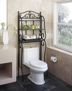 Ornate metal shelf for bathroom to hold knick knacks